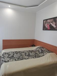 Кровать или кровати в номере Hotel European