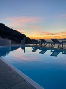 The swimming pool at or near Kokkinos Villas