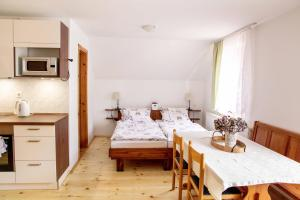 A bed or beds in a room at Ana Antloga Apartments
