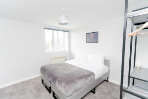 A bed or beds in a room at Dream Apartments Middlesbrough