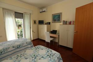 A bed or beds in a room at A Casa di Marta