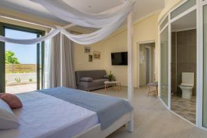 A bed or beds in a room at Arktos Sunset Villa