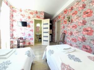 Кровать или кровати в номере Гостевой Дом Ола