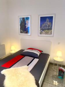 A bed or beds in a room at Chez Coco Apartment 1 Aachen