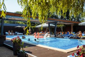 The swimming pool at or near RiverSide- Restaurant, Hotel, Beach