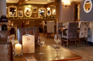 A restaurant or other place to eat at Cross Roads By Greene King Inns
