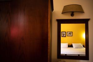 Ένα ή περισσότερα κρεβάτια σε δωμάτιο στο Ξενοδοχείο Πέλοψ