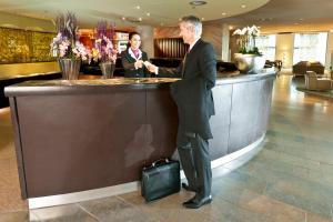 The lobby or reception area at Dorint Hotel am Heumarkt Köln