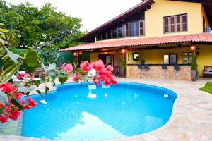 The swimming pool at or close to Pousada Maresias do Cumbuco