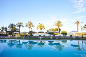 The swimming pool at or near Hotel Port Mahón