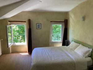 Un ou plusieurs lits dans un hébergement de l'établissement L'Auberge de Reillanne