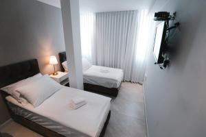 A bed or beds in a room at Unique Hotel Ashdod