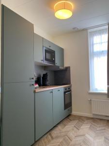 Een keuken of kitchenette bij Les Maisons Domburg