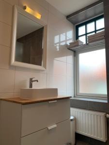 Een badkamer bij Les Maisons Domburg