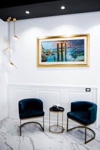 Area soggiorno di Élite Rooms