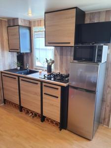 Cuisine ou kitchenette dans l'établissement L'Horizon