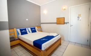 Cama ou camas em um quarto em Hotel Estrela do Sul - Metro Praça da Arvore - 5KM Aeroporto Congonhas