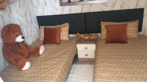A bed or beds in a room at PISO VACACIONAL- EL ALTET