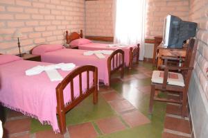 A bed or beds in a room at Hotel El Jardin
