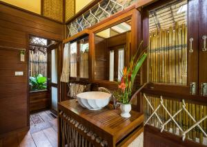 A bathroom at The Float House River Kwai - SHA Certified