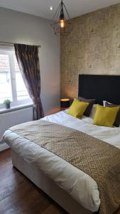 A bed or beds in a room at The George Inn