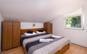 A bed or beds in a room at Apartments Katica