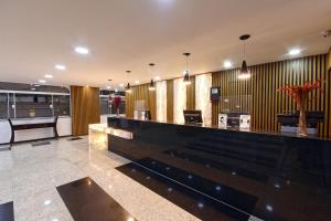 The lobby or reception area at Fênix Hotel Moema