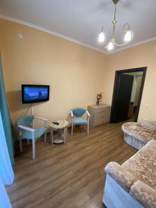 Телевизор и/или развлекательный центр в Гостиница Прометей 2