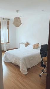 A bed or beds in a room at Casa JyM Fontela 24