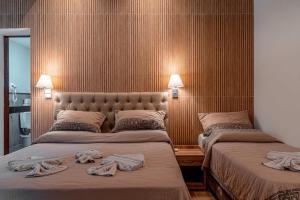 A bed or beds in a room at Hotel Fazenda Santa Barbara