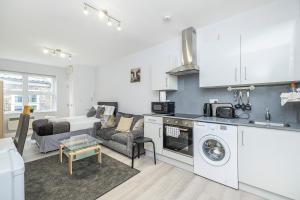 A kitchen or kitchenette at Securematics Kings Studio Apartments
