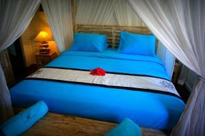 Cama ou camas em um quarto em La Perle De Tahaa