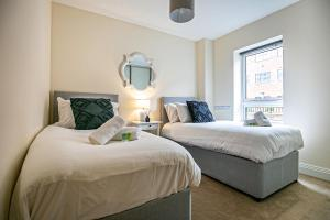 A bed or beds in a room at North Court Watford by Stay Shoal