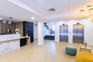 The lobby or reception area at Citadines Wilson Toulouse