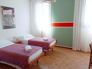 A bed or beds in a room at Casa Accademia
