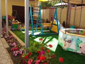 Children's play area at Гостевой дом Радужный
