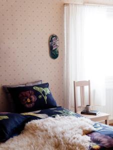 Кровать или кровати в номере Guest House Puukarin Pysäkki