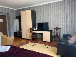 A television and/or entertainment center at Mini-Hotel Pulsar