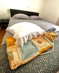 A bed or beds in a room at Maison Laurel