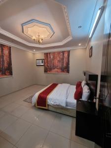 Cama ou camas em um quarto em Janayen Alwed