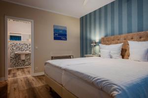 Ein Bett oder Betten in einem Zimmer der Unterkunft Landhaus Alte Eichen