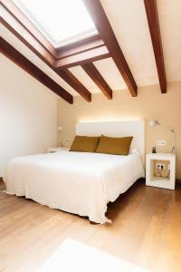 A bed or beds in a room at Hort Sant Patrici - Adults Only