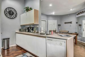 A kitchen or kitchenette at Hollowed Branch Hideaway Condo