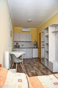 A kitchen or kitchenette at Angéla Vendegház