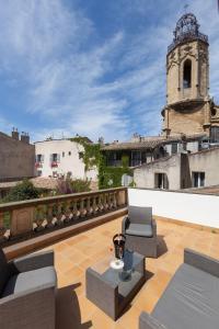 A balcony or terrace at Hôtel des Augustins