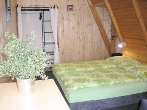 Ein Bett oder Betten in einem Zimmer der Unterkunft Koliba Belveder