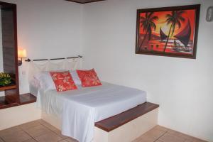 A bed or beds in a room at Pousada Cacimbinha - ePipa Hotéis