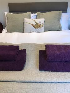 A bed or beds in a room at The Burrow