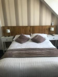 A bed or beds in a room at Burnett Arms