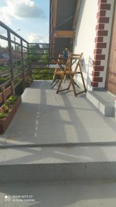A balcony or terrace at Gdow Riverside Apartments and Tours